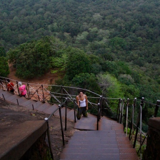 Climbing down from rock structure Sigiriya, Sri Lanka